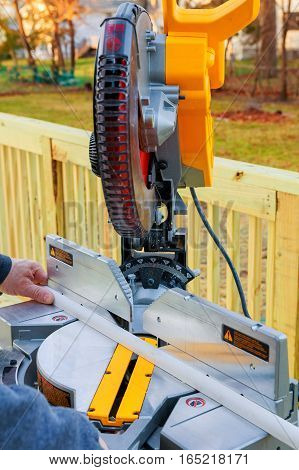 Man, Worker Sawing Wood With A Circular Saw, Machine For  Cutting. The Manufacture Of Furniture.  Ac