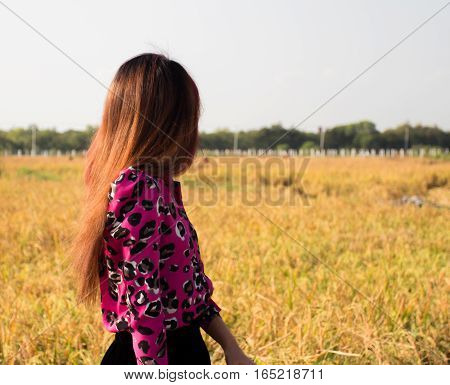 COLOR PHOTO OF GIRL FORM THE BACK
