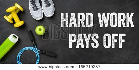 Fitness Equipment On A Dark Background - Hard Work Pays Off