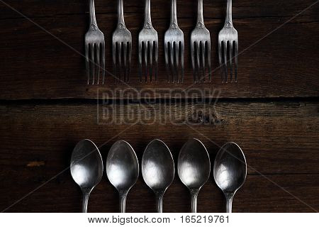 Silver Forks And Spoons On Wooden Background.