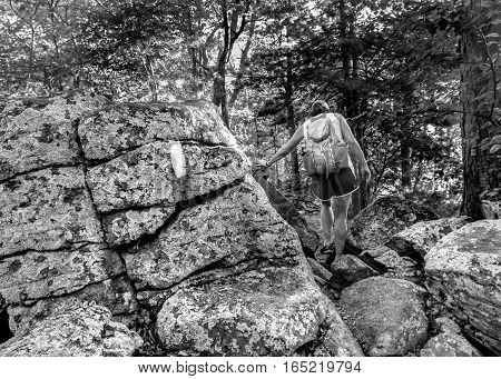 Appalachian Trail Hiker over Boulders in black and white