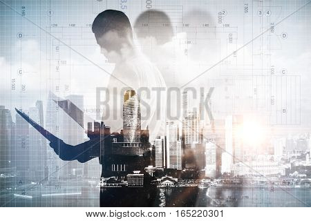 Man with document on abstract city and blueprint background. Double exposure