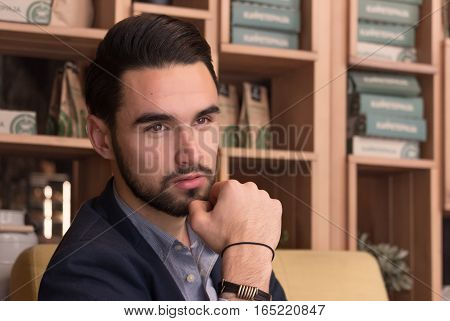 Young Handsome Man Face Head Close Up Hand Beard Indoors