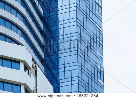 glass high-rise office building on a background of the sky.