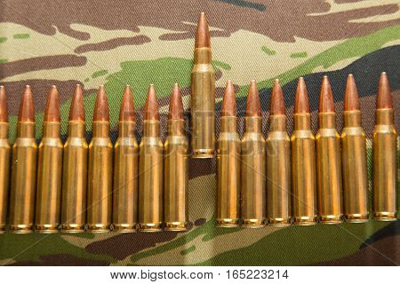 assault rifle bullet. Pile of cartridges of various calibers