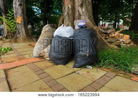 sacks of garbage lay down at pedestrian photo taken in Jakarta Indonesia java