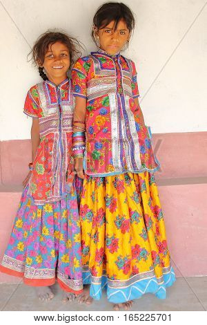 HODKA, GUJARAT, INDIA - DECEMBER 20, 2013: Portrait of two cute and colorful little girls in Hodka, local village near Bhuj