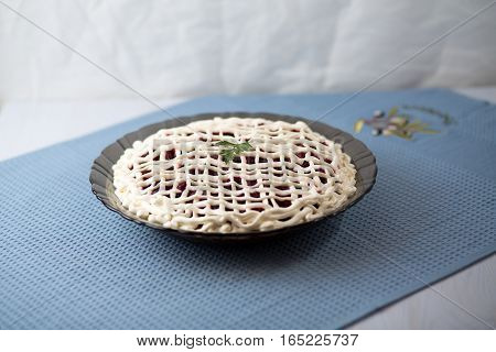 Salad Herring Under A Fur Coat On A Table On A Blue Napkin