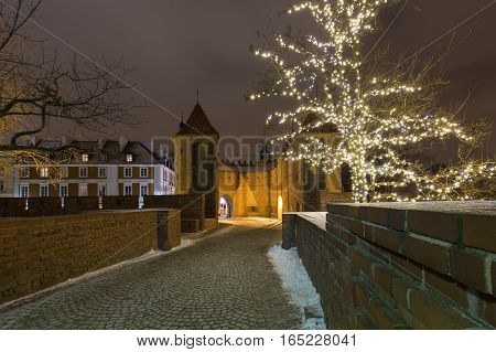 Christmas decorations on the old city in Warsaw. Walls Barbican