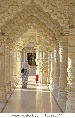 AHMEDABAD, GUJARAT, INDIA - DECEMBER 21, 2013: A woman walking in a jain temple