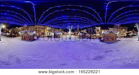 TÂRGU MUREȘ. ROMANIA - December 29, 2016: 360 panorama of decorated wooden booths in winter nighttime in a snow-covered Piața Trandafirilor (Roses' Square), town centre of Târgu Mureș, Romania