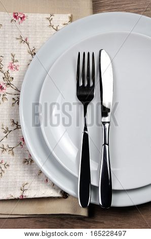 Dining etiquette - I still eat finished. Fork and knife signals with location of cutlery set.