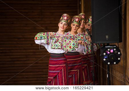Silver Spring, USA - September 17, 2016: Ukraina School of Dance Ensemble dressed in traditional red Ukrainian embroidered costume clothes dancing at 14th Washington Ukrainian festival