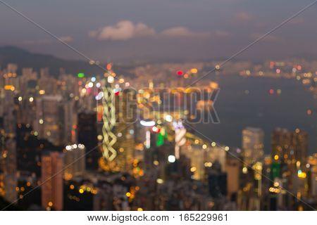 Abstract blurred lights Hong Kong city over Victoria Bay at twilight