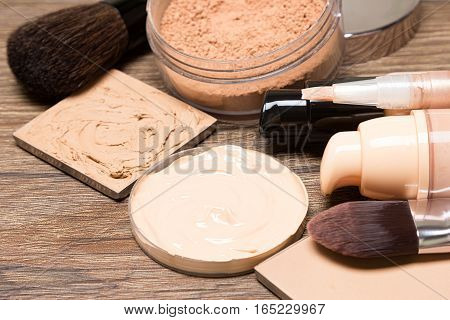 Makeup products to even out skin tone and complexion: foundation, concealer, powder. Selective focus