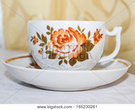 Mug and saucer from the tea set