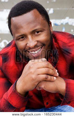 Smiling Young African American Man With Hands Together