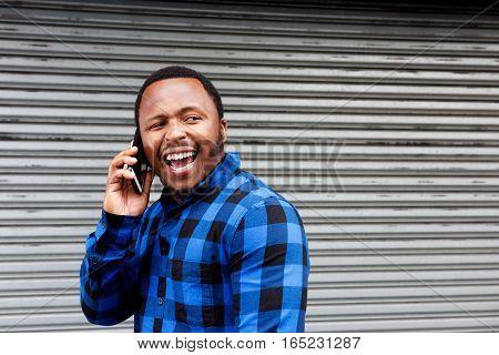 Laughing Man Talking On Mobile Phone