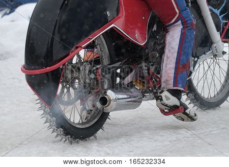 rear view on a running motorcycle for the ice Speedway with driver