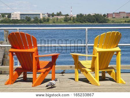 Two colorful chairs on Halifax city promenade (Nova Scotia Canada).