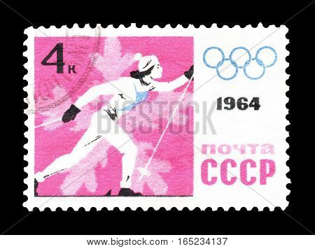 SOVIET UNION - CIRCA 1964 : Cancelled postage stamp printed by Soviet Union, that shows Skier.