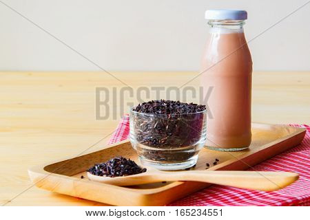 focused rice on the cup Jasmine rice drink for health on wooden background