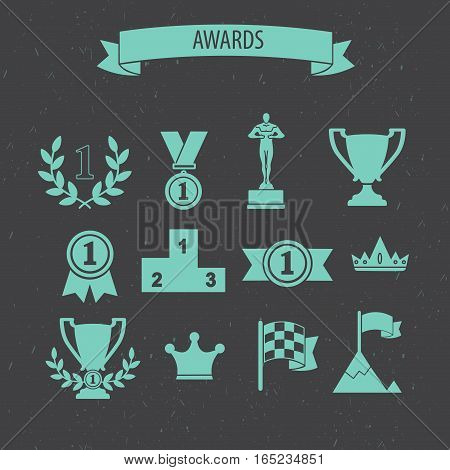 set of award success and victory icons with trophies cups ribbons medals medallions wreath and a podium on grey