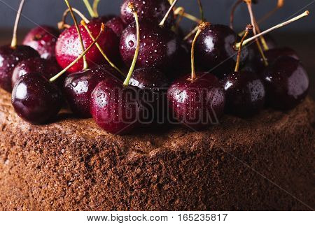 Chocolate cake with cherries on dark background. Cherries. Cherry. Fresh cherries. sweet food concept Copyspace