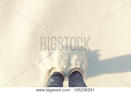 Women Foots In A Large Depth Of Snow