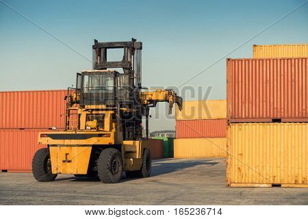Heavy forklift truck in the ship yard. Container forklift.