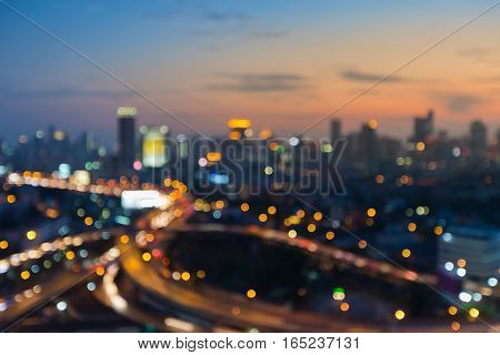 Abstract blurred light city and highway with sunset sky background