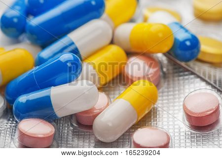 medical pills different colors in plastic the containers on medical background