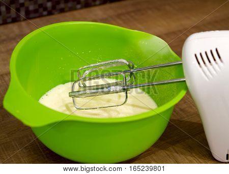 beaten eggs in a bowl mixer cook