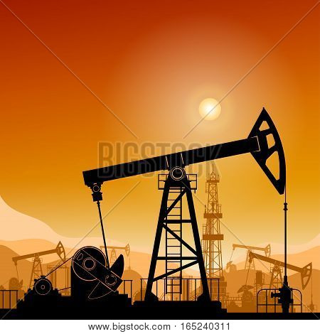 Silhouette Pumpjack or Oil Pump on a Background of Mountains at Sunset ,Petroleum Industry in the Background Working Oil Pumps and Drilling Rig