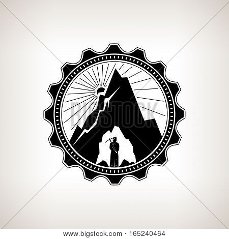Miner in the Helmet is Holding Pickaxe in the Bowels of the Mountain on a Background of the Sunburst ,Label or Badge Mine Shaft ,Mining, Vintage Emblem of the Mining Industry