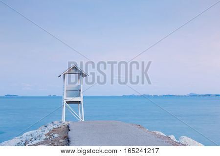 Lifeguard station over rocky road with blue sky