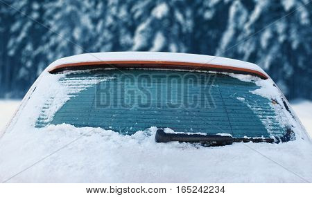 Winter Frozen Back Car Window, Texture Freezing Ice Glass Over Snowy Background