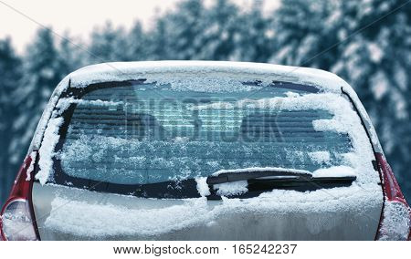 Winter Frozen Back Car Window, Texture Freezing Ice Glass With Snow Over Snowy Background