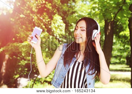 Young Beautiful Woman Listening Music With Headphones Outdoors