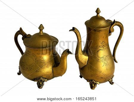 Antique brass coffeepot and teapot with a pattern isolated on white background