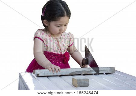 Little girl sawing plank with a handsaw. Isolated on white background.
