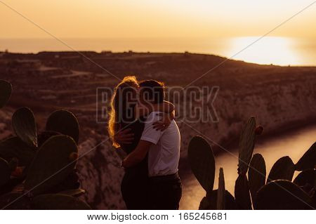 Couple Embrace In The Evening On The Seaside
