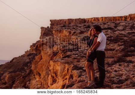 Couple Kissing In The Evening On The Seaside