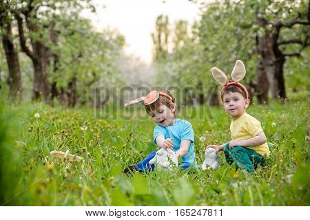 Two Little Kids Boys And Friends In Easter Bunny Ears During Tra
