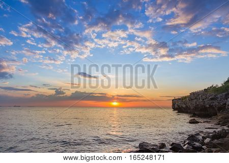 Sunset over the seacoast skyline with beautiful natural sky natural lanscape background