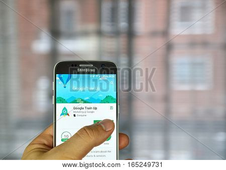 MONTREAL CANADA - DECEMBER 23 2016 : Google Train Up on Samsung S7 screen. The app is designed for retail sales professionals to keep users up to date on the latest Google products and services.