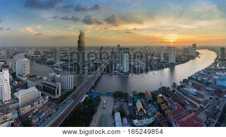 Aerial view Bangkok city and river curved during sunset skyline background Thailand