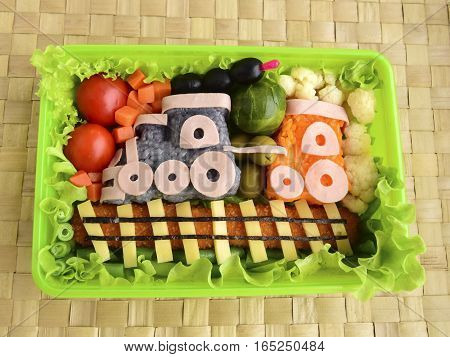 The train is made of rice. Kyaraben, bento. Creative food for children