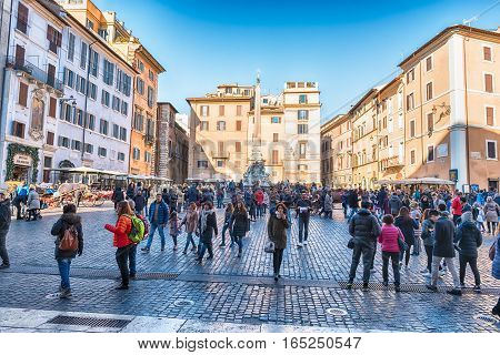ROME - DECEMBER 16: People walking in the crowded Piazza della Rotonda in front of the Pantheon Rome Italy December 16 2016