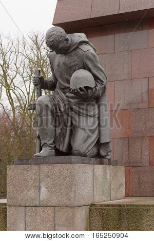 BerlinBundesrepublik Deutschland- December 292016: The entrance to the alley memory guard kneeling soldiers in Treptov Park